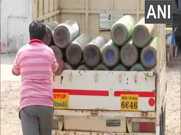 Oxygen cylinders being loaded for supply to hospitals in Pune.