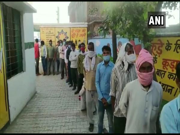 Voters queue up at Devapur Primary School in Moradabad.