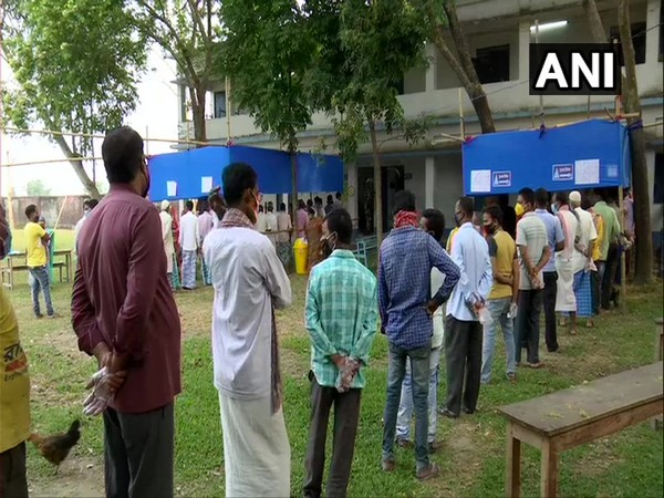Voters queue up at booth number 175 in Islampur, North Dinajpur on Thursday. [Photo/ANI]