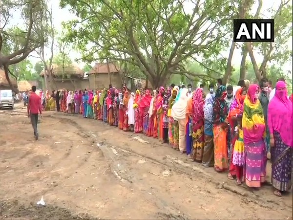 Voters queue up at a polling booth in Banpara during the sixth phase of West Bengal polls on Thursday. [Photo/ANI]
