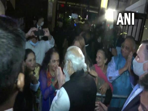 Prime Minister Narendra Modi greeting members of Indian Diaspora outside a hotel in New York. (Photo/ANI)