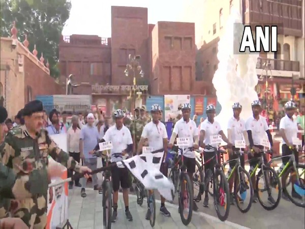 BSF DIG Bhupendra Singh flagging off BSF's cycle rally from Jallianwala Bagh, Amritsar (Photo/ANI)