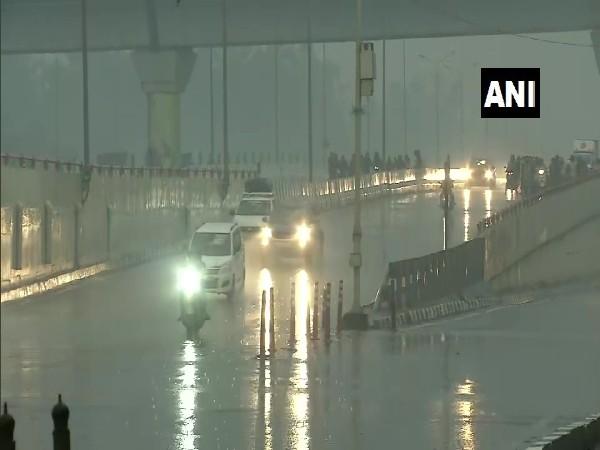Rain lashes NH-24 in East Vinod Nagar area on Sunday morning (Photo/ANI)