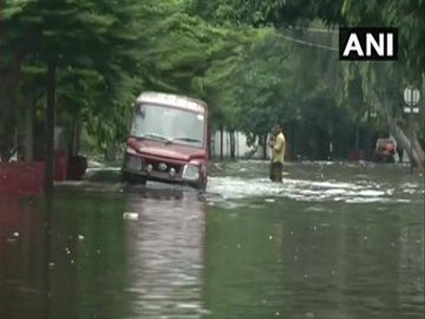 A vehicle wading through a water-logged road of Bihar. [Photo/ANI]