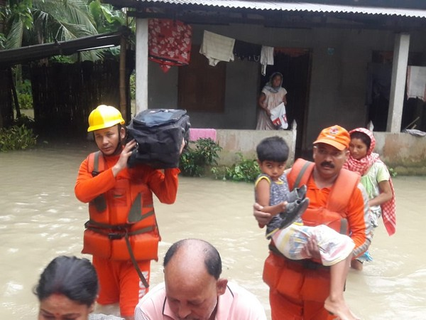 Visuals of NDRF officials rescuing people.
