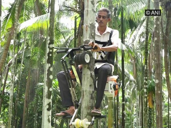 Framer Ganapathi climbing Areca nut tree using his ingenious bike