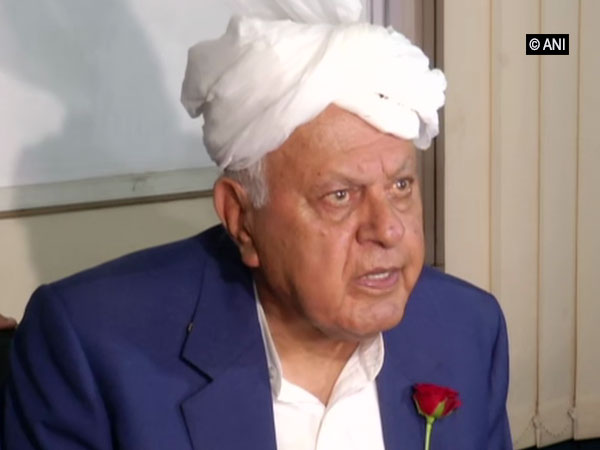 National Conference chairman Farooq Abdullah speaking to reporters in Jammu on Friday.