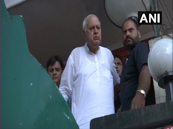 National Conference leader Farooq Abdullah speaking to reporters from his house in Srinagar