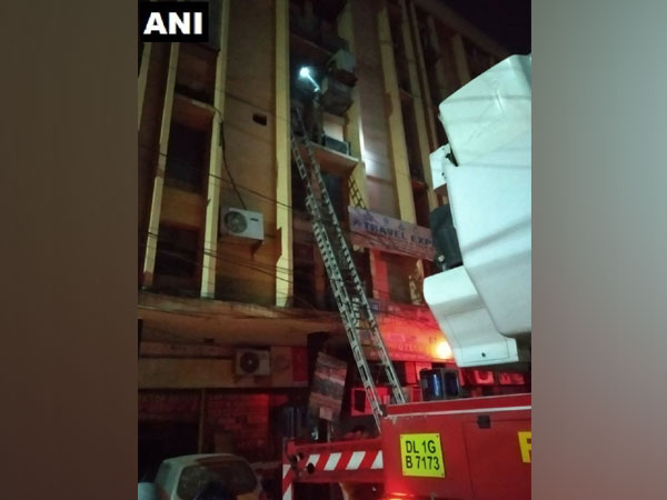 Fire breaks out in a building on Shankar Road, New Delhi on Wednesday.