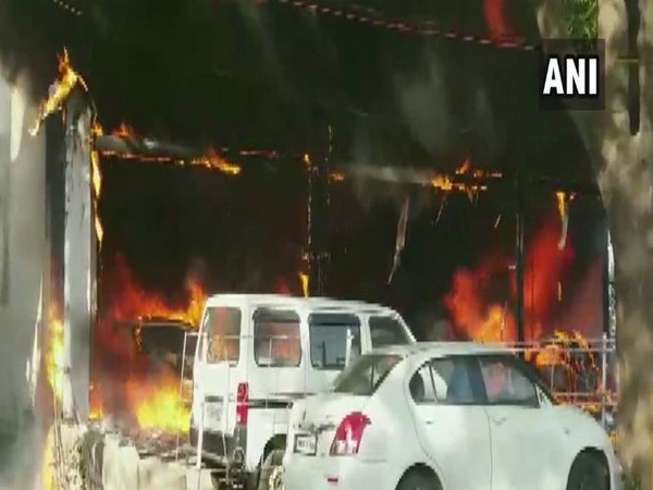 Visuals from the car showroom which caught fire in Betul on Sunday. Photo/ANI