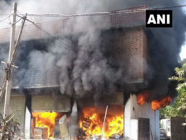 Visual of the fire which broke out at the godown in Mandi on Saturday. Photo/ANI