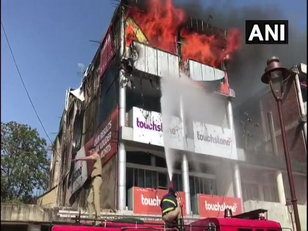 Fire fighter trying to douse the fire in Chandigarh on Monday. Photo/ANI