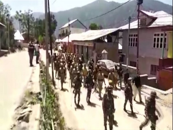 Security forces on Saturday carried out flag march in Kishtwar, Jammu and Kashmir. Photo/ANI