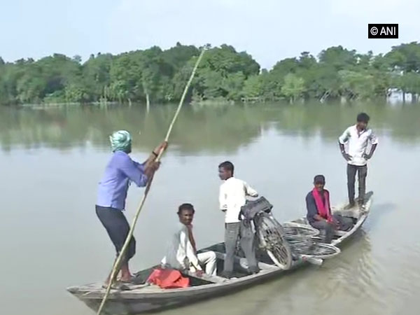 Villagers using boat to travel during flood in Darbhanga, Bihar on July 18. Photo/ANI