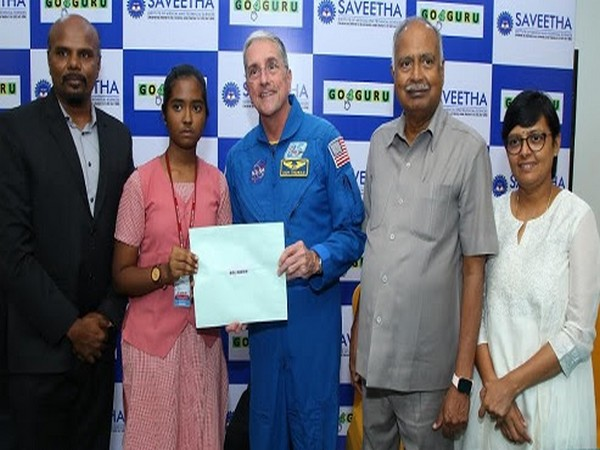 Former NASA Astronaut Dr. Don Thomas handing over flight ticket to winner of National Space Science Contest 2019, J. Dhaanya Thasnem to visit NASA