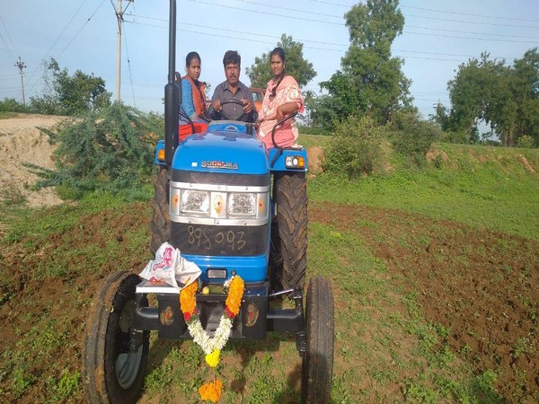 Nageswara Rao, a farmer from Chittoor district, driving his new tractor gifted by actor Sonu Sood.