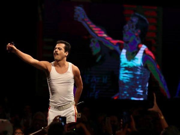 A cosplayer costumed as Freddie Mercury performs during the Sao Paulo Comic Con Experience in Sao Paulo, Brazil