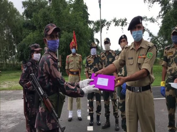 Officials of BSF and BGB exchanged sweets in Fulbari on Eid al-Adha. (Photo/ANI)