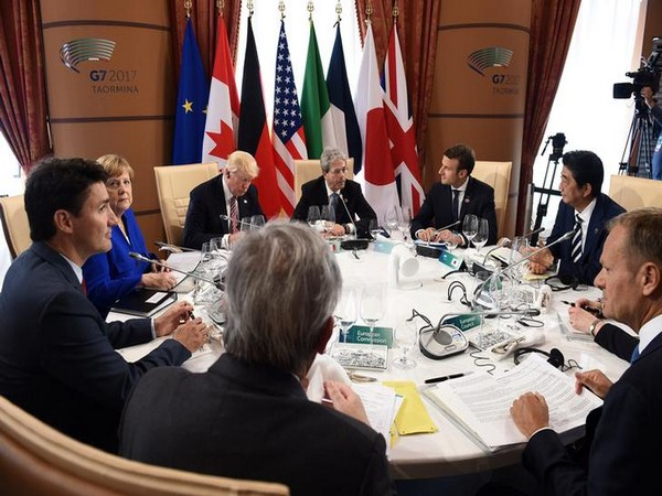 World leaders attend a Working Session at the G7 summit.
