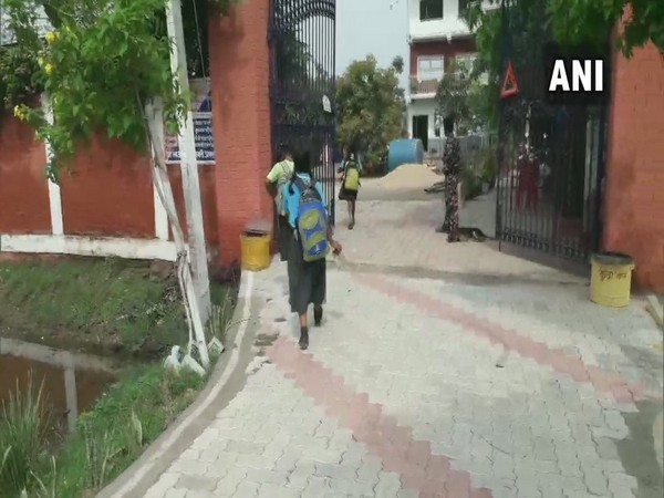 The students disposing waste materials that they have collected while their way to school in Gaya. Photo/ANI