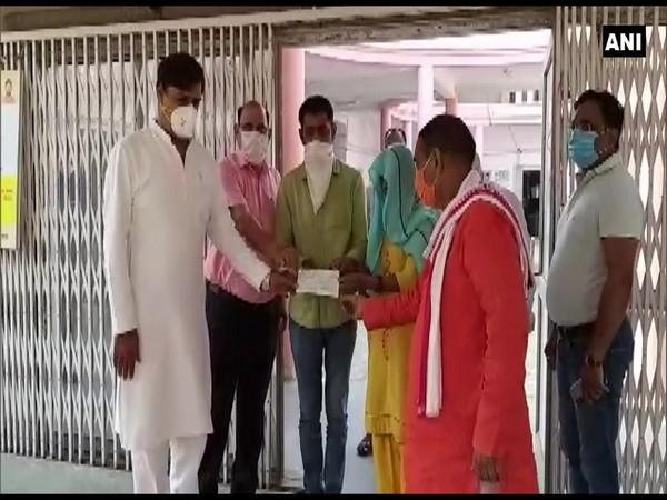Rajya Sabha MP, Dadri MLA, Additional DM handed over Rs 15 lakh cheque to family of late Sudiksha Bhati on Sunday. (Photo/ANI)