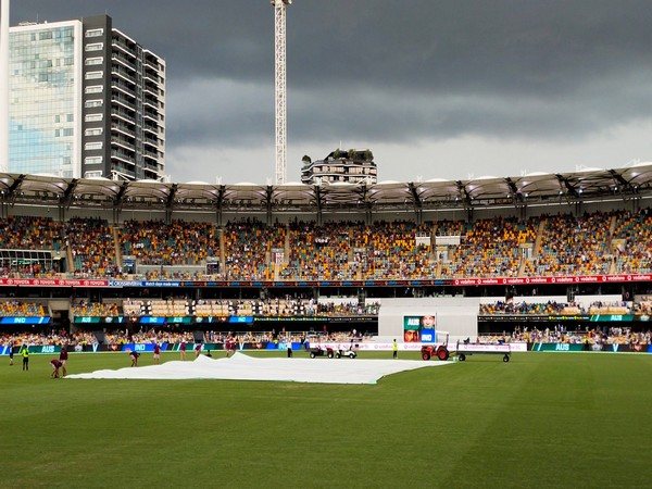 The pitch has been covered at The Gabba (Photo/ BCCI Twitter)