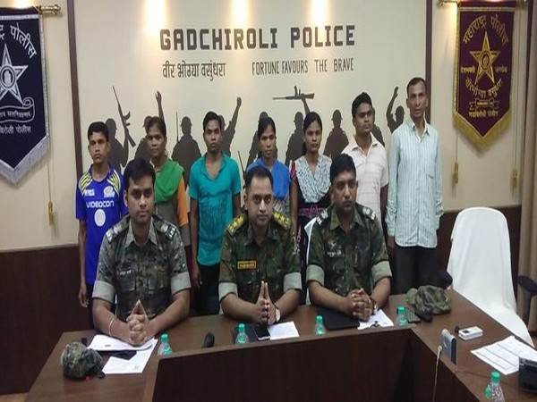 The surrendered Naxals with the Gadhchiroli police team on Wednesday. Photo/ANI