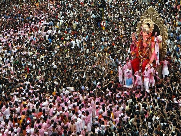 Devotees carry a statue of Ganesha, the deity of prosperity and knowledge