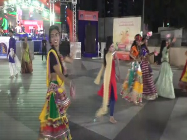 Students and teachers of Institute of Design and Technology perform 'Garba' holding sanitary napkins in their hands. Photo/ANI