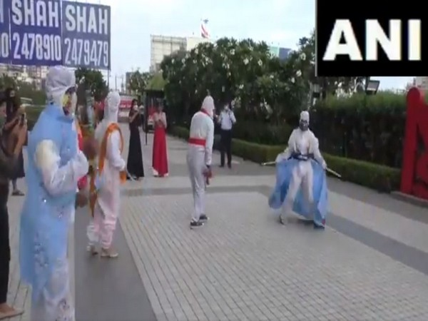 A group of fashion designing students perform garba wearing PPE kits in Surat, Gujarat. (Photo/ANI)