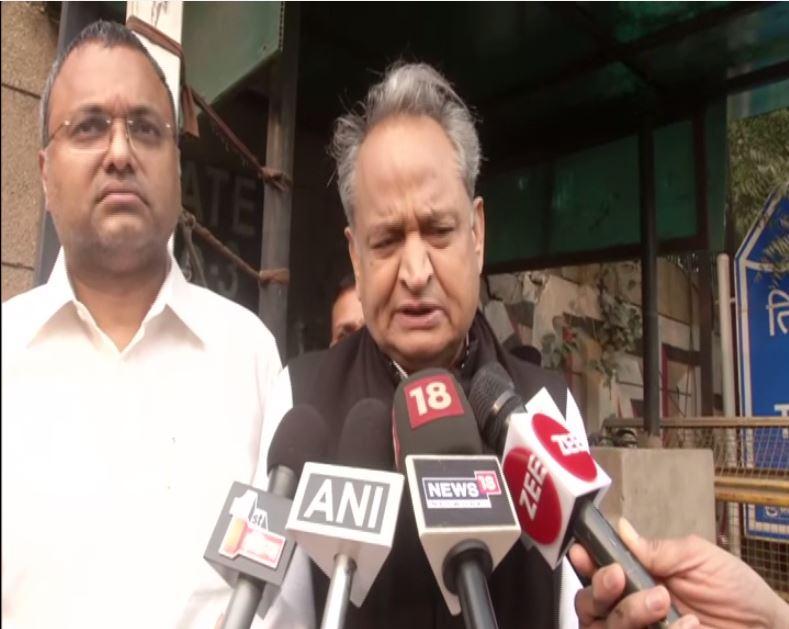Ashok Gehlot with Karti Chidambaram, speaking to reporters in New Delhi on Friday. Photo/ANI
