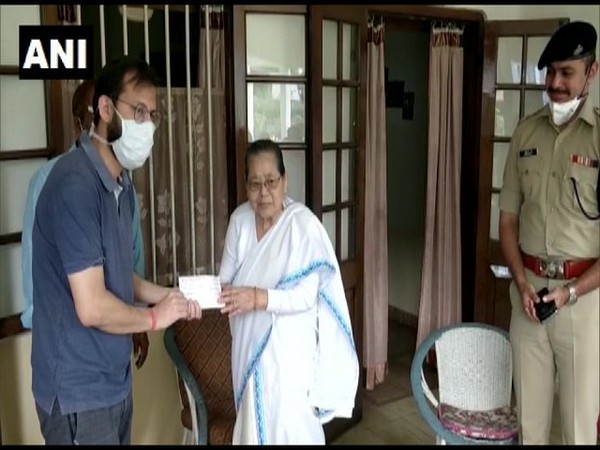 Shanti Gogoi handed over the cheque to Dibrugarh DC on Friday. Photo/ANI