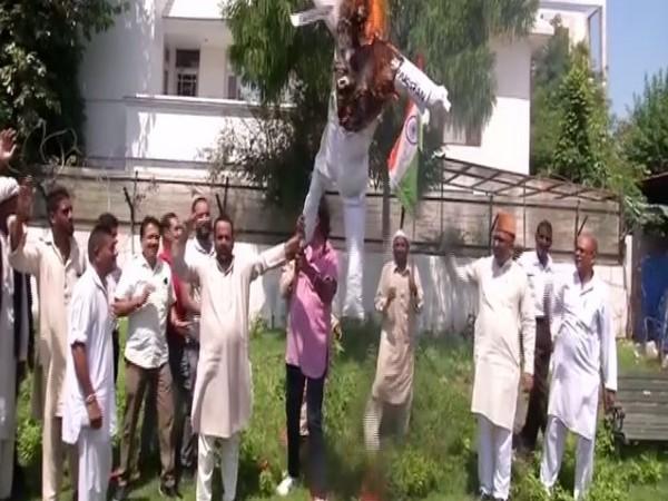 Protesters outside the Bharatiya Janata Party headquarters in Jammu on Wednesday. Photo/ANI