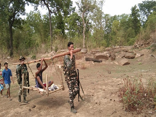 CRPF personnel carrying the ailing boy on a cot on Thursday. (Photo: ANI)