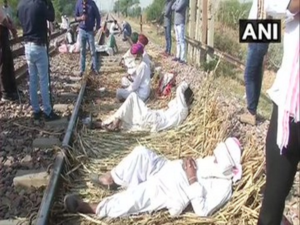 Gurjar protestors blocked railway tracks in Bharatpur on Monday. (Photo/ANI)