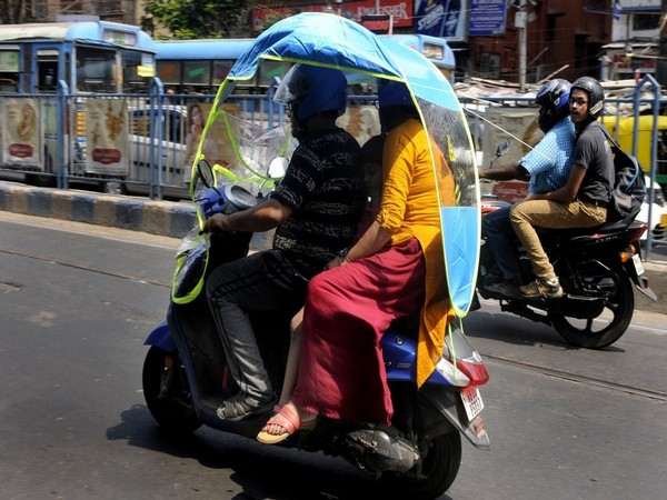Bikers start using China made two-wheeler cover to protect themselves from the heat on a hot day in Kolkata on Friday.