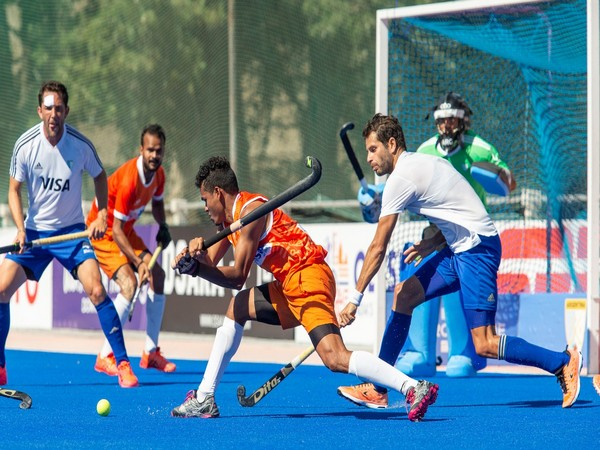 Indian player Shilanand Lakra taking shot on goal against Argentina. (Photo/ Hockey India)