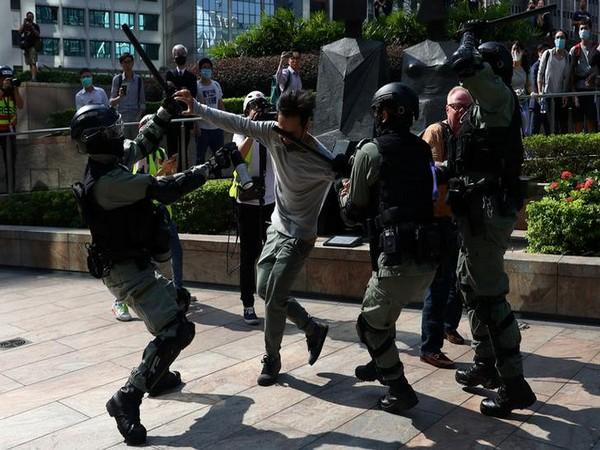 Hong Kong Police manhandling a pro-democracy protester.