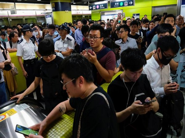 Anti-government demonstrators block metro services in Hong Kong on Tuesday.