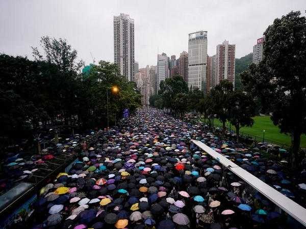 Thousands of anti-government protesters braved torrential rains on Sunday as they marched along the main thoroughfares of Hong Kong Island