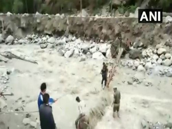 Police rescuing the locals at Kharogla Nalla