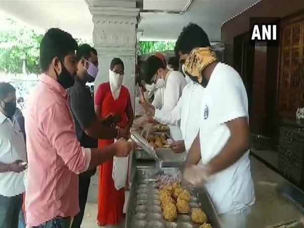 Devotees gather at Himayat Nagar after TTD resumed sale of laddus. (Photo/ANI)