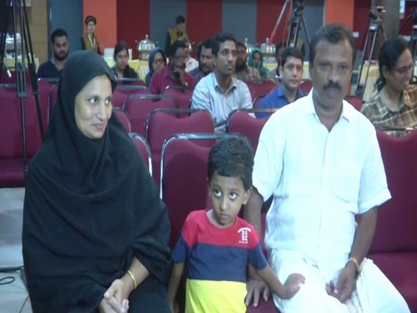 Three-year-old Mohammad Haidan with his parents in Kochi on Thursday. Photo/ANI