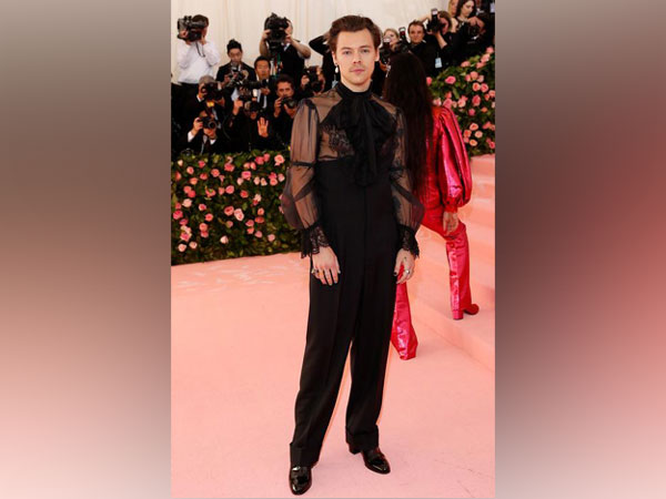 0368dae1057 Harry Styles hits the Met Gala in sheer Gucci top