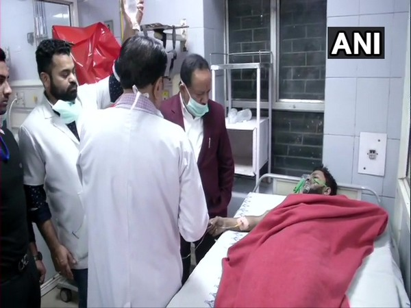 Union Health Minister Harsh Vardhan meeting one of the Anaj Mandi fire victim at LNJP Hospital in New Delhi on Sunday.