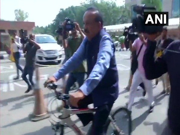 Union Minister Dr Harsh Vardhan rides a bicycle to take charge of Ministry of Health and Family Welfare in New Delhi on Monday.