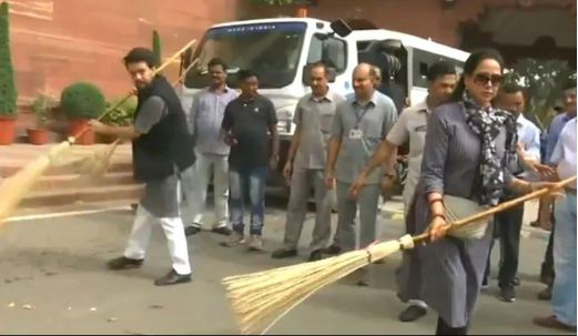 BJP MP Hema Malini at a cleanliness drive at Parliament along with MoS Aurag Thakur on July 13. (Photo/ANI)