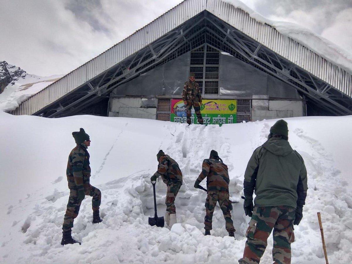Army men clear the path to Hemkunt Sahib Gurudwara in Uttrakhand