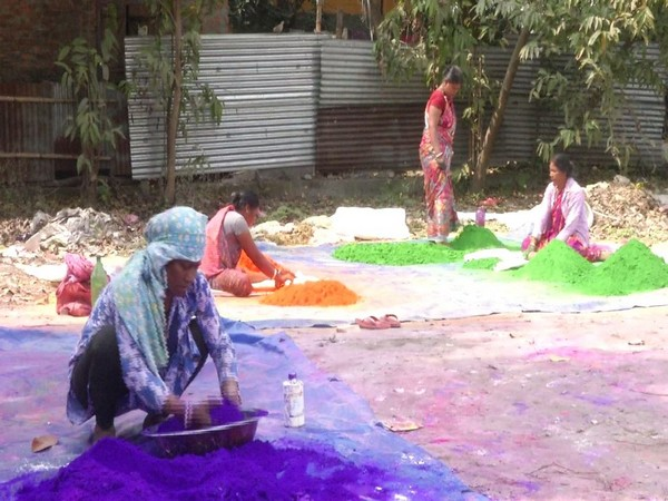 Workers making natural colours for Holi in Siliguri. Photo/ANI