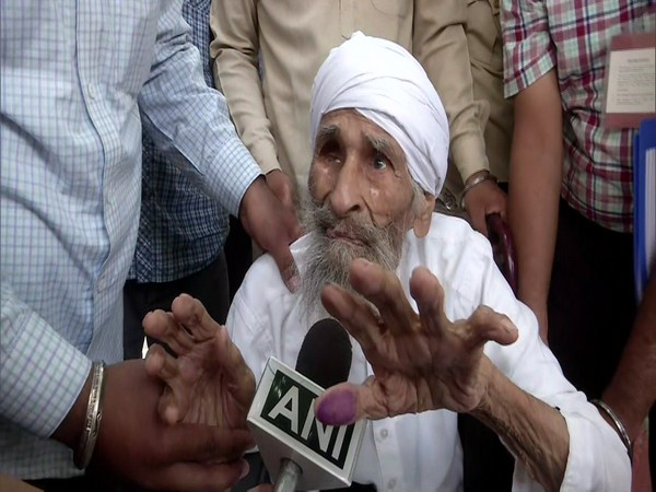 Delhi's oldest voter, 111-year old Bachan Singh after casting his vote at a polling booth in Sant Garh. (Photo/ANI)